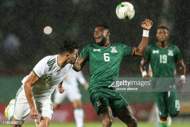 November 2019, Algeria, Blida: Algeria's Baghdad Bounedjah and Zambia's Tandi Mwape battle for the ball during the 2021 Africa Cup of Nations...