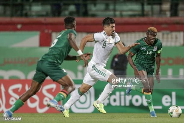 November 2019, Algeria, Blida: Algeria's Baghdad Bounedjah and Zambia's Kabaso Chongo vie for the ball during the 2021 Africa Cup of Nations...