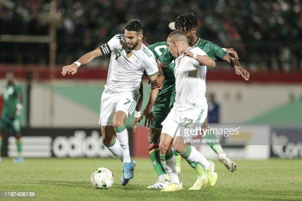 November 2019, Algeria, Blida: Algeria's Riyad Mahrez and teammate Ismael Bennacer in action during the 2021 Africa Cup of Nations qualifying Group...