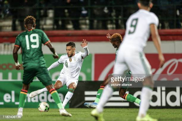 November 2019, Algeria, Blida: Zambia's Nathan Sinkala and Algeria's Youcef Belaili battle for the ball during the 2021 Africa Cup of Nations...
