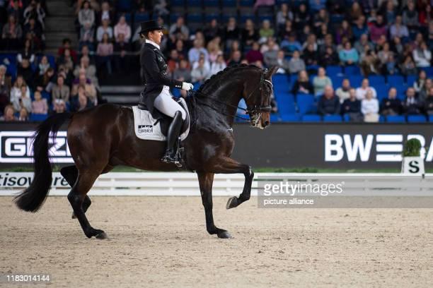 November 2019, Baden-Wuerttemberg, Stuttgart: 35th Stuttgart German Masters, Equestrian Sport, Dressage, Master: Germany's Lisa Müller rides her...