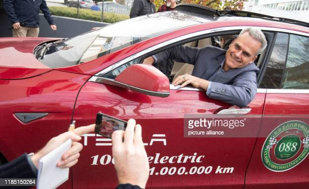 November 2019, Baden-Wuerttemberg, Stuttgart: Hansjörg Freiherr von Gemmingen-Hornberg sits in his Tesla Model S, built in 2013. Since today his...