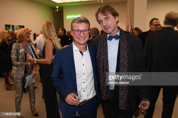 Bernd Sibler Bavarian Minister of State for Science and Art and the art historian Bernhard Maaz celebrate at the PIN Party 2019 in the Pinakothek der...
