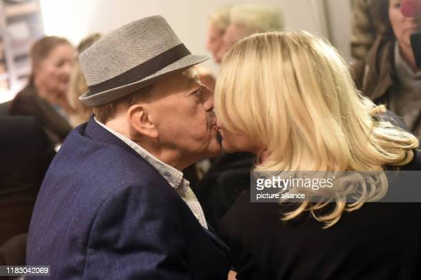 Joseph Hannesschläger actor and his wife Bettina Geyer kiss before the premiere of his film Schmucklos Der Film at the RioFilmpalast The comedy and...
