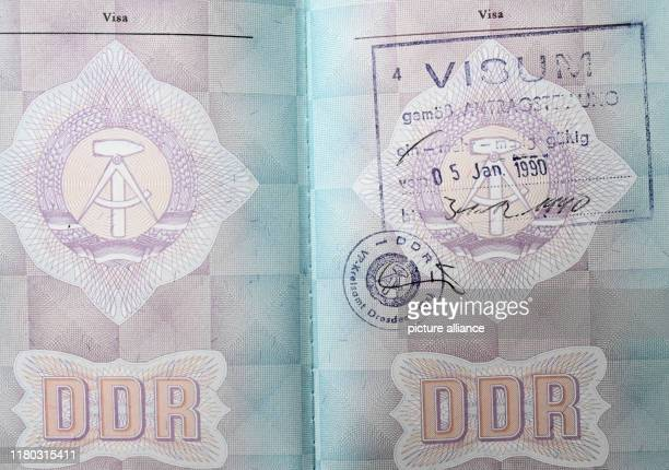 A GDR passport with a visa for western travel valid from 5011990 to Photo Bernd Settnik/dpaZentralbild/ZB