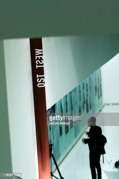 November 2019, Berlin: A guest stands in front of the newly opened memorial object. On the occasion of the 30th anniversary of the fall of the Berlin...