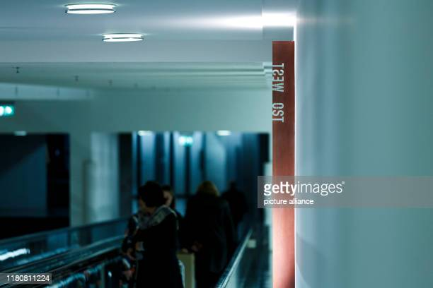 November 2019, Berlin: Employees of the Bundestag walk past the newly opened memorial object. On the occasion of the 30th anniversary of the fall of...