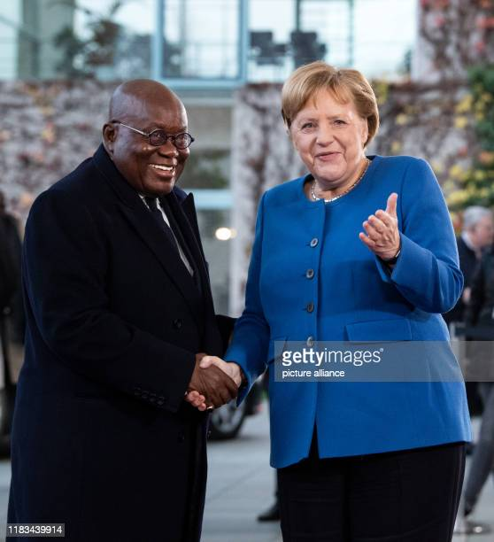 Federal Chancellor Angela Merkel welcomes Nana Addo Dankwa AkufoAddo President of Ghana to the Compact with Africa conference at the Federal...