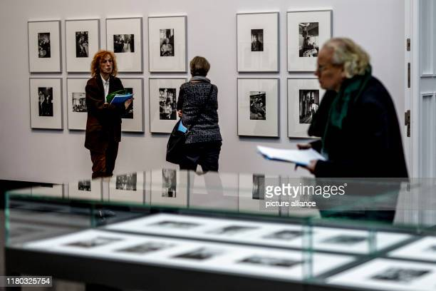 November 2019, Berlin: Guests go on a preview tour through the exhibition of the works of the German photographer Helga Paris. The exhibition shows...