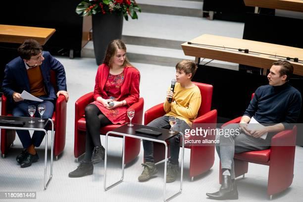 November 2019, Berlin: Robert Ide , Tagesspiegel, Emma Rickert, Malte Kutschick and Jahannes Hendrik Langer, actors, sit at the school competition of...