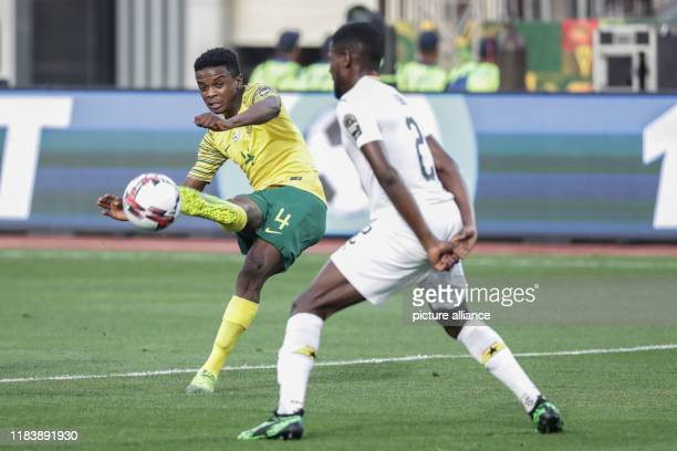 South Africa's Teboho Mokoena and Ghana's Fobi Kingsley battle for the ball during the Africa U23 Cup of Nations 3rd place soccer match between South...