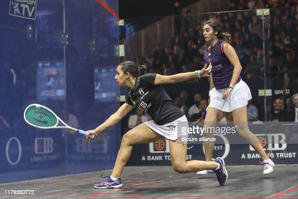 Egyptian squash player Raneem El Welily in action against her compatriot Nour El Sherbini during their women's singles final match of the PSA Women's...
