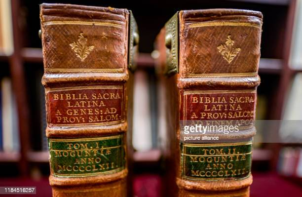The two volumes of a Bible from Gutenberg's printing press which are auctioned off in an anniversary auction of valuable books are on red velvet at...