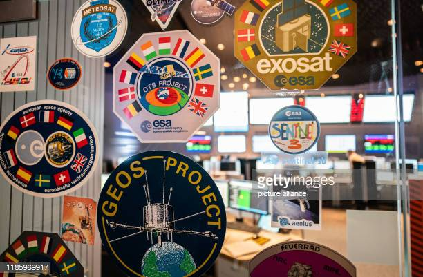 Stickers from previous missions are affixed to a glass door at the entrance to the ESOC Control Centre of the European Space Agency ESA The flight of...