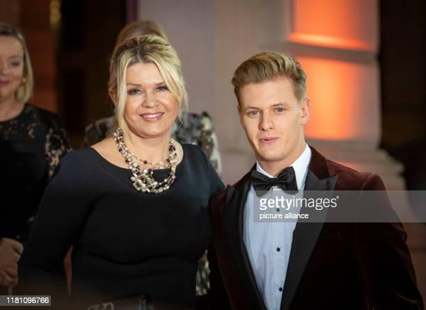 November 2019, Hessen, Frankfurt/Main: Corinna Schumacher and her son, racing driver Mick Schumacher , arrive at the Alte Oper before the start of...
