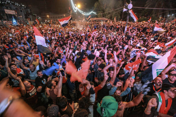 IRQ: Protesters Watch Soccer Team Win Against Iran In Baghdad