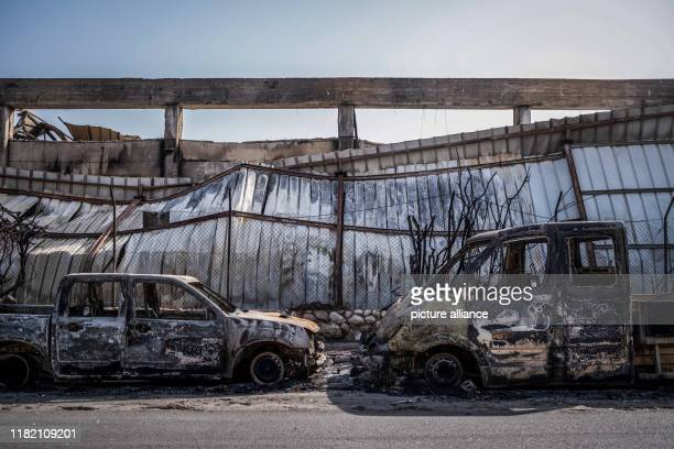 November 2019, Israel, Sderot: Burned cars sit after yesterdays rocket fire in industrial area of Sderot. Israel and militants in the Gaza Strip...