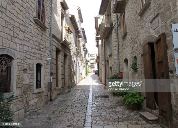 """November 2019, Italy, Oratino: A small street, during the day the village is abandoned. Oratino is a member of the association """"The most beautiful..."""