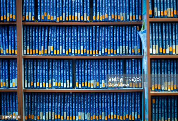 """November 2019, Mecklenburg-Western Pomerania, Parchim: Thousands of film titles are available for rent on the shelves of the video library """"Video..."""