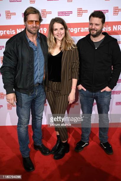 November 2019, North Rhine-Westphalia, Cologne: The actor Henning Baum and Leonie Brill and director Peter Thorwarth come to an event for the...