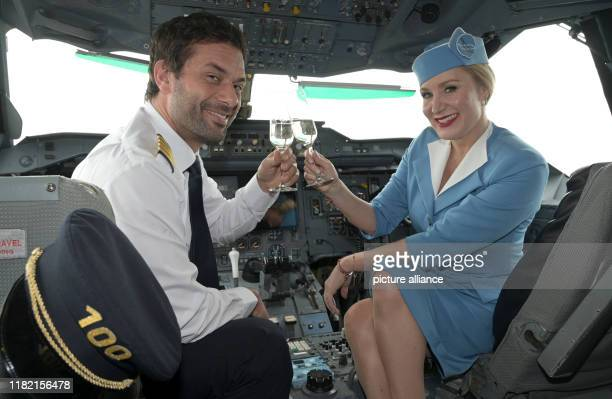 13 November 2019 North RhineWestphalia Cologne The actors Kai Schumann and Janine Kunze sit in the cockpit of an airplane while filming the 100th...