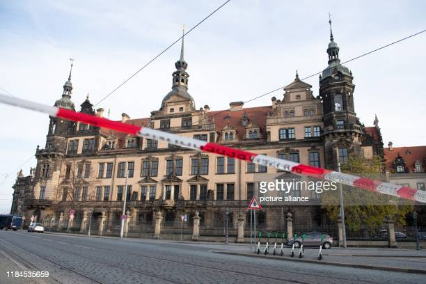 A police barrier tape hangs in front of the Residenzschloss with the Green Vault Dresden's Treasury Green Vault was broken into early in the morning...