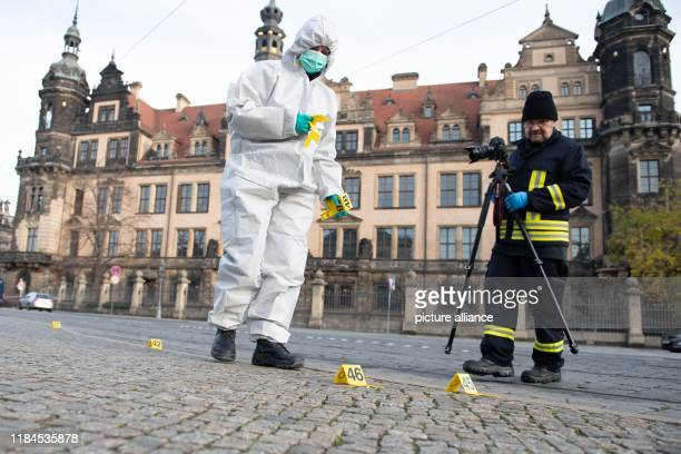 November 2019, Saxony, Dresden: Two policemen stand in front of the residence castle with the Green Vault. Dresden's Treasury Green Vault was broken...