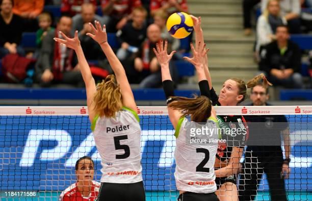 Volleyball women DVV Cup Dresdner SC Ladies in Black Aachen Dresden's Kadie Rolfzen Aachen's Tessa Polder and Aachen's Aziliz Divoux in action Photo...