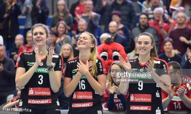 Volleyball women DVV Cup Dresdner SC Ladies in Black Aachen Dresden's Emma Cyrus Brie King and Lucija Mlinar are happy about their game victory Photo...