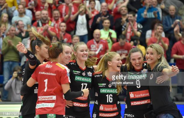 Volleyball women DVV Cup Dresdner SC Ladies in Black Aachen Dresden's Emma Cyrus Brie King and Lucija Mlinar are happy about their victory Photo...