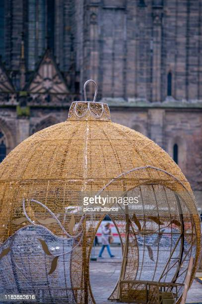 22 November 2019 SaxonyAnhalt Magdeburg A chain of lights ball stands on the cathedral square The installation belongs to the world of lights that is...