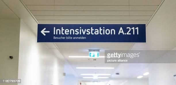 08 November 2019 SchleswigHolstein Lübeck A sign with the inscription Intensivstation Besucher bitte eintreten shows the way in the UKSH Centre...
