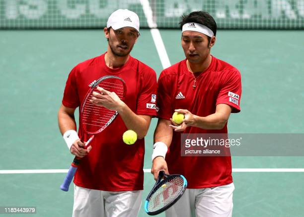Tennis men Davis Cup group stage Group A France Japan doubles Japan's Ben McLachlan and Yasutaka Uchiyama after the match Photo Cezaro De Luca/dpa