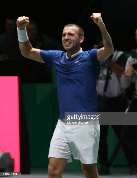 November 2019, Spain, Madrid: The tennis player Daniel Evans from Great Britain celebrates versus Jan-Lennard Struff from Germany plays versus , for...