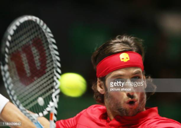 November 2019, Spain, Madrid: The tennis player Feliciano López from Spain plays versus Kyle Edmond fron Great Britain, for the Semifinals of Davis...