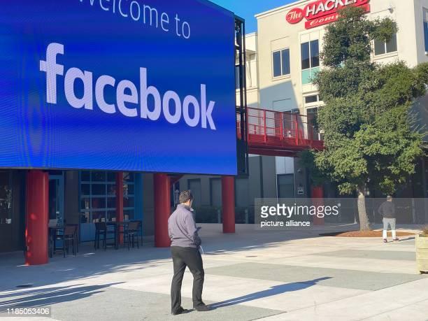 November 2019, US, Menlo Park: An employee of the Internet company Facebook walks through the courtyard of the company campus in Menlo Park,...