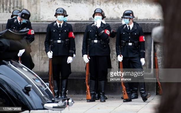November 2020, Bavaria, Munich: Actors and extras in Nazi uniforms and with face masks can be seen at the Musikhochschule during the shooting of the...