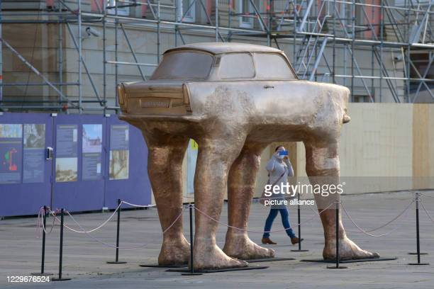 A young woman films the Trabi sculpture on Steubenplatz next to the Landtag with her smartphone The artwork Quo Vadis by Czech artist David Cerny was...