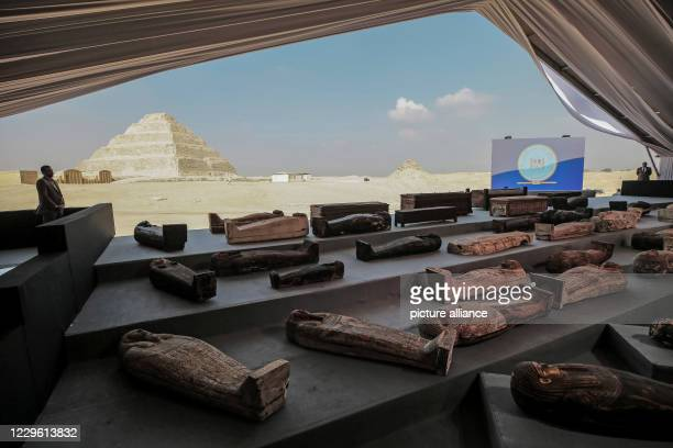 Ancient sarcophagi are displayed during a press conference at Saqqara Egyptian antiquities officials announced the discovery of at least 100 ancient...