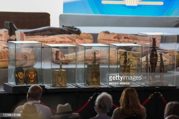 November 2020, Egypt, Giza: Attendees look at newly discovered Ancient sarcophagi and statues during a press conference at Saqqara. Egyptian...