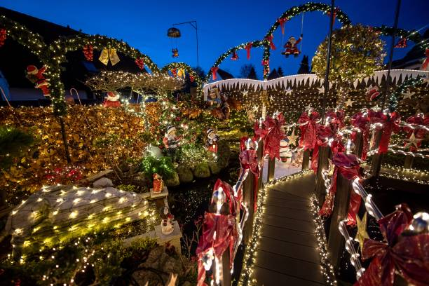 DEU: Family Decorates House At Christmas Time With 60 000 Lights