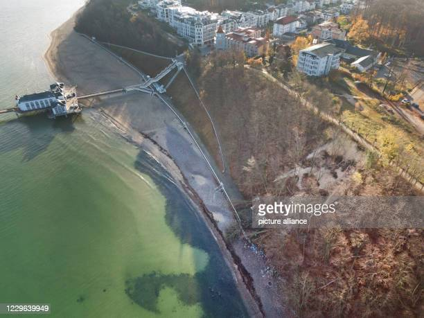 November 2020, Mecklenburg-Western Pomerania, Stralsund: Close to the pier a large area of the slope slipped down on . According to the municipality,...