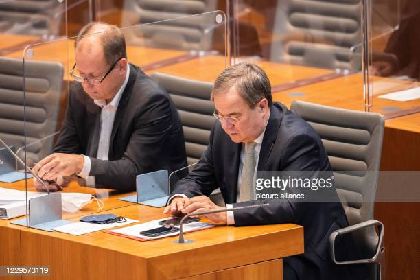 November 2020, North Rhine-Westphalia, Duesseldorf: Armin Laschet , Minister President of North Rhine-Westphalia, and Joachim Stamp , Minister for...