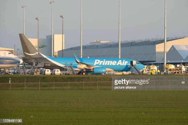 November 2020, Saxony, Schkeuditz: A Boeing 737-800 is parked at Leipzig-Halle Airport. The plane is flying for the online retailer Amazon. Photo:...