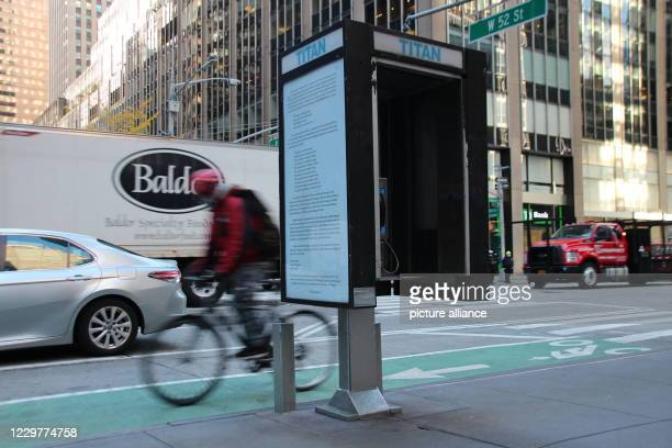 November 2020, US, New York: A phone booth, redesigned by the artist Yvonne Rainer, stands on the edge of a Manhattan street. The telephone booths...