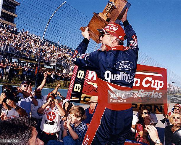 Dale Jarrett celebrates his NASCAR Cup championship after the running of the NAPA 500 at Atlanta International Raceway Jarrett finished second to...