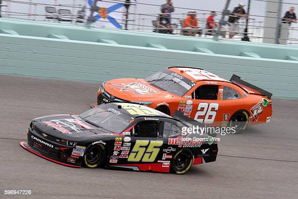 Anthony Kumpen and TJ Bell during the running of the Ford EcoBoost 300 at Homestead-Miami Speedway in Homestead, FL