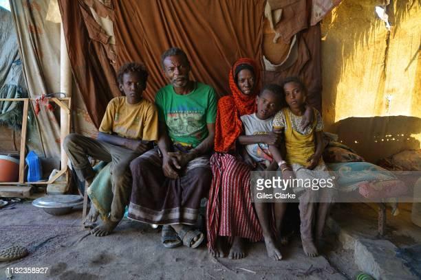DISTRICT ADEN YEMEN November 21 2018 A family pose in their hut on November 21 2018 in the Dar Saad district in AdenYemen The family who fled Al...