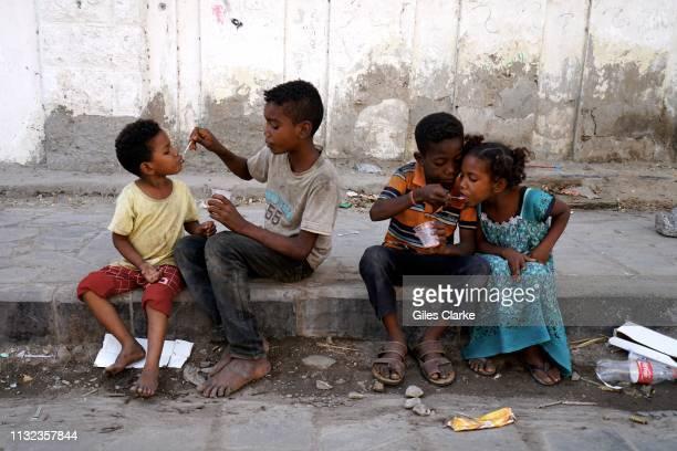 November 21 2018. Children eating on the street on November 21, 2018 in Aden, south Yemen.
