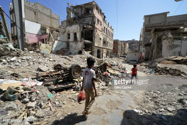 November 21 2018. Children walk by bombed-out buildings on November 21, 2018 in Aden, south Yemen.